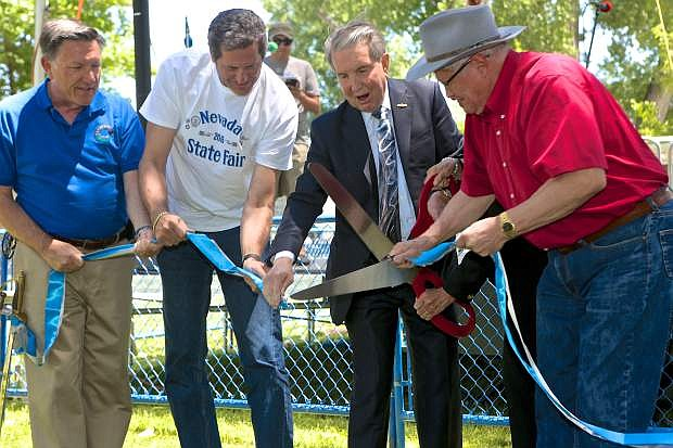 City, state and fair dignitaries cut the ribbon signigfying the opening of the Nevada State Fair Thursday in Mills Park.