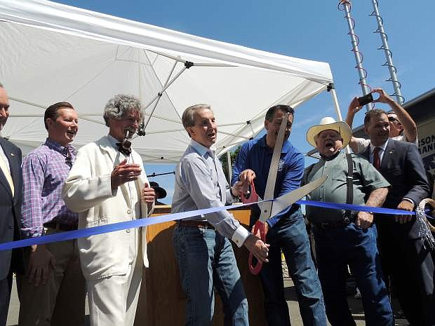 From left, Ben Keckheifer, Mark Twain, 'aka McAvoy Layne,' Carson City Mayor Robert Crowell and Gov. Brian Sandoval help officially kick off the NV150 Fair with other dignataries on Thursday.