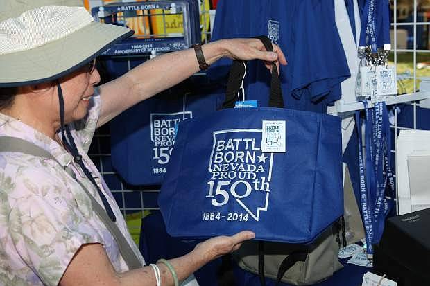 Phyllis Askew of Carson City purchases a NV150 bag at the fair Saturday.