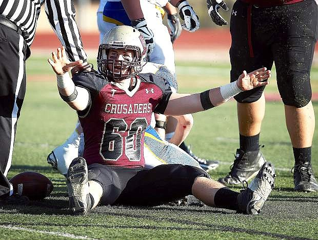 Matthew Chilman of Faith Lutheran celebrates after making a tackle against Lowry in the Division I-A state semifinal football game at Faith Lutheran High School in Las Vegas last week.