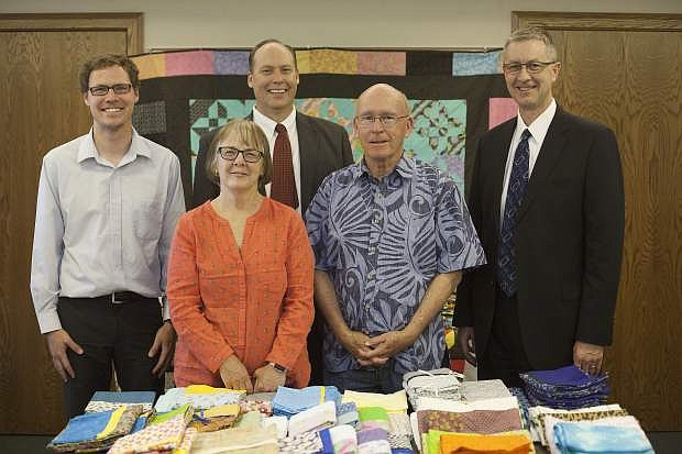 Steve Mulvenon and Gina Session, executive board members of the Northern Nevada International Center, attended the quilt showcase. From right to left, President Doug Peterson of the Carson City Nevada Stake, Steve Mulvenon and Gina Session of the Northern Nevada International Center, Curtis Palmer and Scott Jones of the Carson City Nevada Public Affairs Committee.