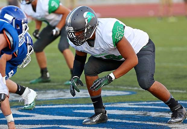 Fallon's TJ Mauga crouches in the scrimmage against Carson last week.