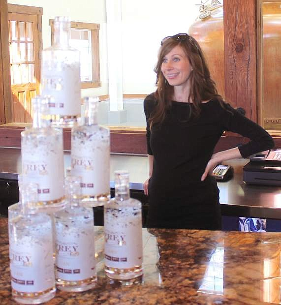 Ashley Frey stands behind bottoles of the Frey Ranch Gin, which officially rolls out on Saturday at a tasting event.