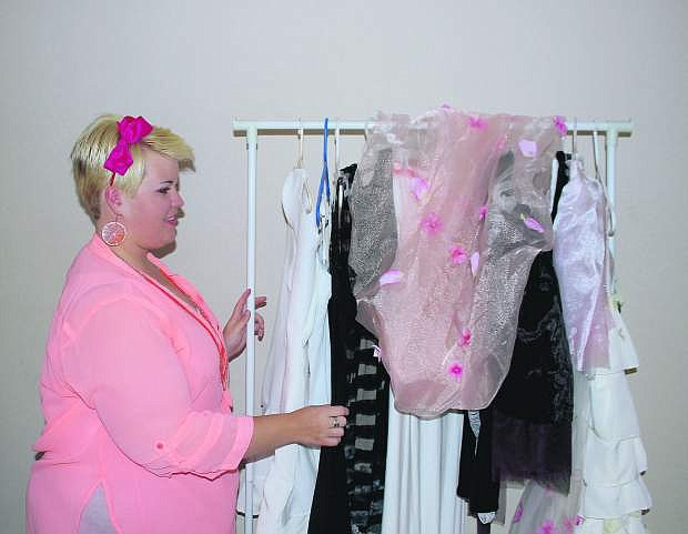 Ashlee Marie Donovan flips through her garments she has created for the Reno Fashion Show.
