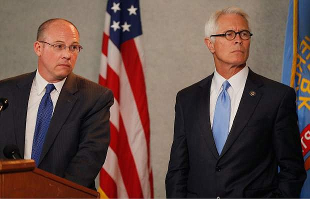 U.S. Attorney Berry Grissom, right, and Johnson County District Attorney Steve Howe, left, listen to a question during a news conference in Overland Park, Kan., Tuesday, April 15, 2014. Kansas prosecutors filed state-level murder charges Tuesday against white supremacist, Frazier Glenn Cross, who is accused in a shootings that left three people dead at two Jewish community sites in suburban Kansas City on Sunday. (AP Photo/Orlin Wagner)