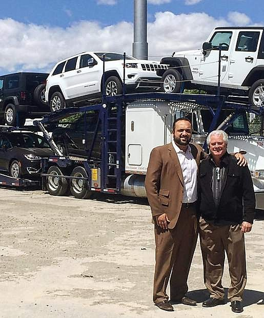 Moe Golshani (left) and Don Weir pose on the lot of Fernley Chrysler Dodge Jeep Ram dealership,