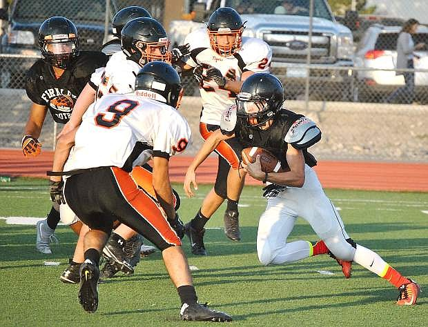Fernley senior quarterback Kyle Throckmorton runs the option during the Vaqueros' scrimmage against Douglas last week. Fernley opens the season today at 7 p.m. against Hug.