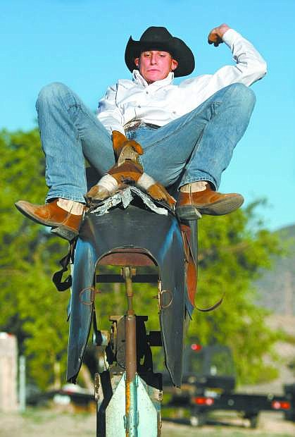 Cody Kiser practices on a mechanical bull at his Mound House home in this Nevada Appeal file photo.