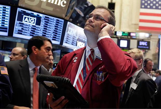 Trader William Lawrence works on the floor of the New York Stock Exchange Wednesday, Sept. 17, 2014. Financial markets are awaiting the end of a Federal Reserve meeting Wednesday to see whether the Fed sends any clearer signal about the timing of an interest rate increase. (AP Photo/Richard Drew)