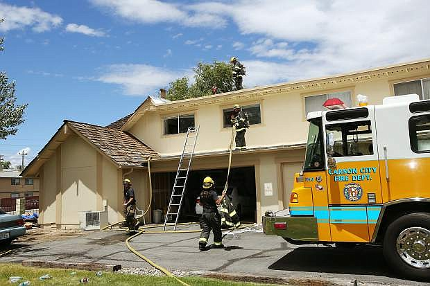 Firemen responded to a fire that damaged two units of an apartment building in Carson City on Friday.