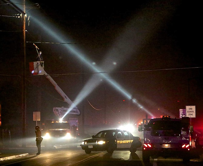 Nevada Energy works to restore power to the area Thursday night.