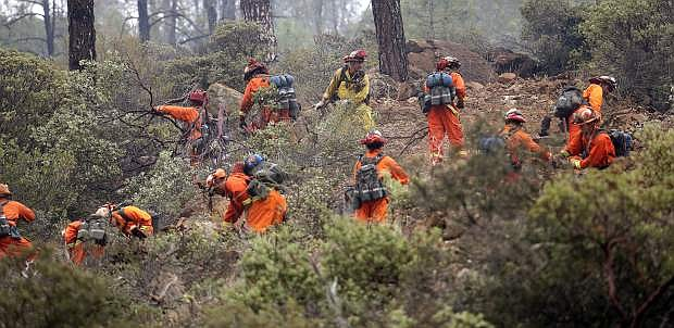 Firefighters work on a ridge line as they clear brush Monday, Sept. 14, near Middletown, Calif. As part of National Preparedness month, federal and state officials are reminding residents to be prepared in the event of a wildfire threatening the Tahoe Basin.