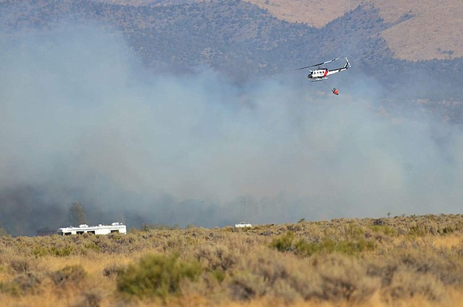 A helicopter that was fighting the Frontage Fire on Sunday.