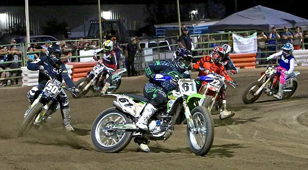 Racers battle for position during a senior heat race Saturday night at the Outlaw Flat Track races at Fuji Park.