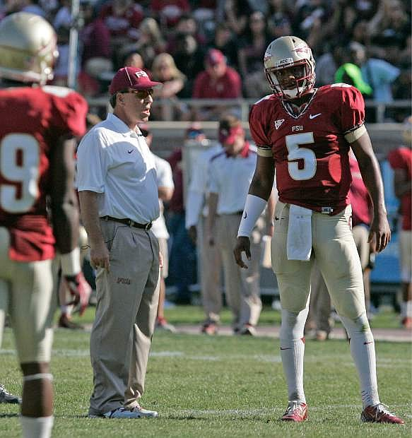 Florida State's head coach Jimbo Fisher talks with garnet quarterback Jameis Winston in the second half of their spring NCAA college football game on Saturday, April 12, 2014, in Tallahassee, Fla. The Garnet team won the game over coming the Gold squad 31-14. (AP Photo/Steve Cannon)