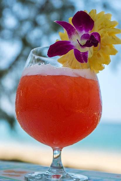 Delicious Mai Tai Cocktail with pineapple on gorgeous beach
