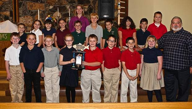 Amanda Manning's 4th grade class at Bethlehem Lutheran School poses for a photo with F.I.S.H.'s Tony Zehring (far right) on Friday. The class won movie tickets at Galaxy Fandango for collecting the most food during the 'Trick or Treat' food drive.