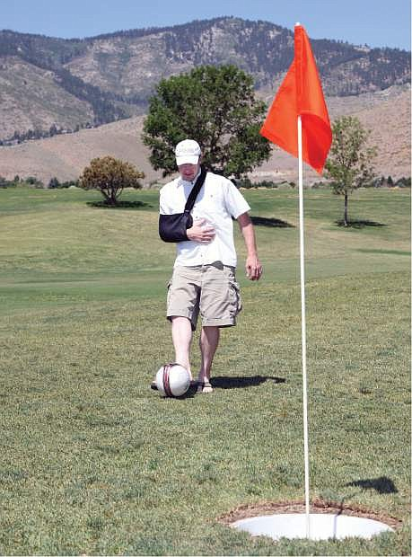 Rob Mason, PGA Head Pro at Silver Oak Golf Course, tries out the first footgolf hole recently.