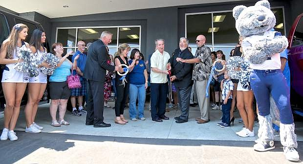 Carson City Mayor Bob Crowell and Capital Ford owner Dick Campagni cut the ribbon at the Grand Re-opening of the dealership on S. Carson St. Saturday afternoon. Guests were treated to live music, raffle prizes and food during the event.