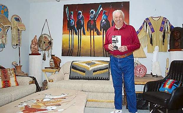 "Adam Fortunate Eagle displays his book, ""Pipestone: My Life in an Indian Boarding School,"" at his Fallon home in 2012."