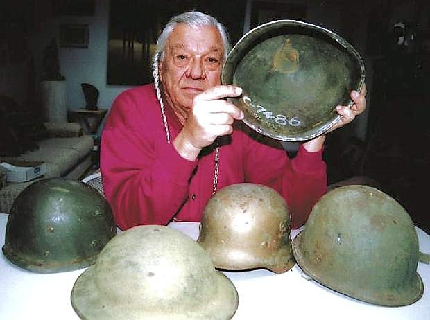 Adam Fortune Eagle, seen here holding a U.S. military helmet in this Nov. 2007 file photo, led the Native American occupation of Alcatraz Island in San Francisco Bay in 1969.