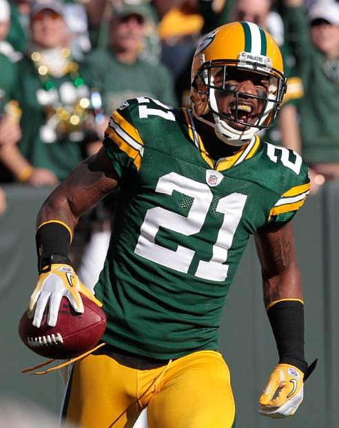 FILE - In this Sunday, Oct. 2, 2011 file photo, Green Bay Packers cornerback Charles Woodson (21) reacts after running back an interception for a touchdown during the first half of an NFL football game against the Denver Broncos, in Green Bay, Wis. Most of the big names hitting NFL free agency in 2013 aren't big stars anymore. While Ed Reed is coming off a Super Bowl season in Baltimore and Wes Welker catches 100 passes every year, this crop is more about aging defensive players such as Woodson, Brian Urlacher and Ronde Barber. (AP Photo/Mike Roemer, File)