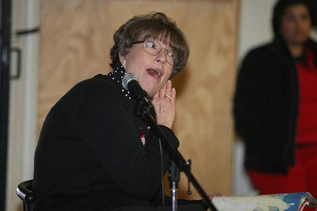 """Fritsch Elementary School principal Mary Garey reads """"Santa Claus and the Three Bears"""" by Maria Modugno. Garey led the students in a sing-a-long of Christmas carols and read children's books to celebrate the season before leaving Friday for a two-week break. Students in the Carson City School District will return to classes on Jan. 6."""