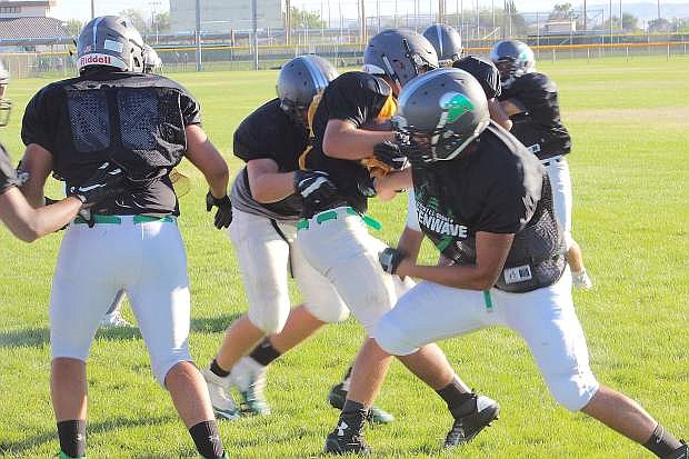 The varsity offense scout team gives the Greenwave a look at what to expect tonight in the season opener at Fernley.