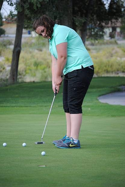 Fallon golfer Sarah Evans watches her putt during a practice session last week.