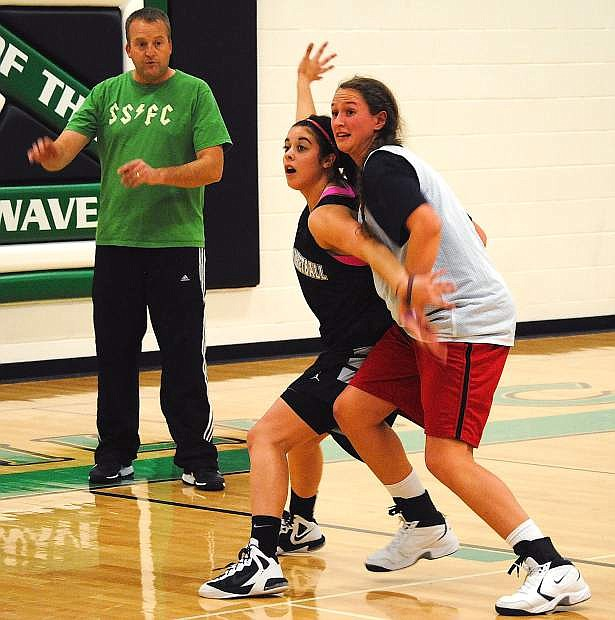 Fallon's Ali Tedford, middle, posts up against Hannah Lindsay, right, during pracitce as assistant coach Nate Waite looks on. The Lady Wave open the season Tuesday at 6 p.m. against Lassen at the Elmo Derrico Gym.