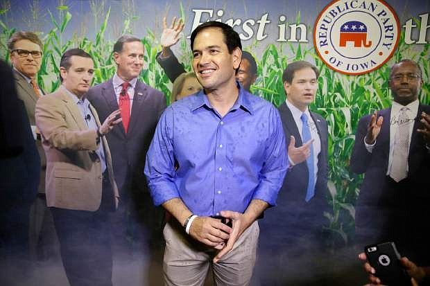 Republican presidential candidate, Sen. Marco Rubio, R-Fla., visits the Republican Party of Iowa booth during a visit to the Iowa State Fair, Tuesday, Aug. 18, 2015, in Des Moines, Iowa. (AP Photo/Charlie Neibergall)