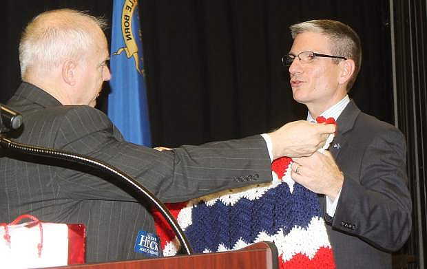 oiug Hill presents a gift from his mother, Edna Van Leuven,  to Congressman Joe Heck at Friday's Lincoln Day Dinner in Fallon.