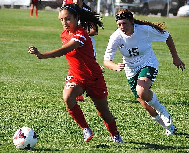 Truckee's Natalie Seelenfreund races past Fallon's Madison Perazzo during the Wolverines' 3-0 on Tuesday.