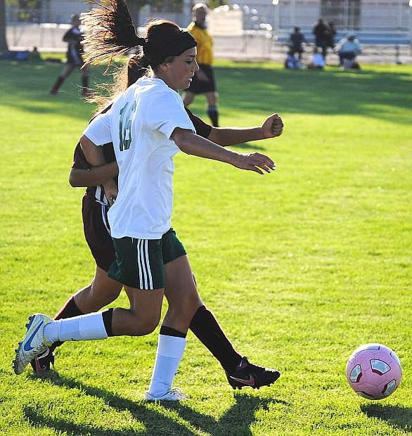 Lady Wave forward Kayla Biggs fights off a Sparks defender during Fallon's 5-0 win on Tuesday.