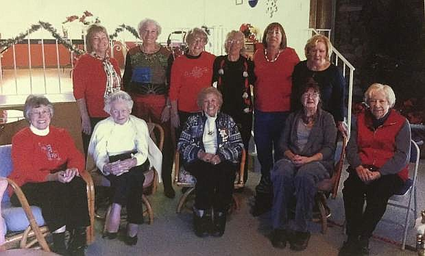 Members of the Mark Twain Garden Club are seen at their holiday celebration. From the left, front row, are Gillian Mellor, secretary; Gertrude Gottschalk; Mary Lou Pawley, vice president; Cyndy Brenneman; and Elaine Berge. From the left, back row, are Sable Shaw, treasurer; Bonnie Bullis; Ann Wagner; Lorraine Walsh; Judy Hammock and Marge Cole, president. Members not pictured are Jackie Baily, Eileen Bianchi; Glendanne Block; Gladys Crum; Pat Holb; Jo Saulisberry; and Greta Weyant.