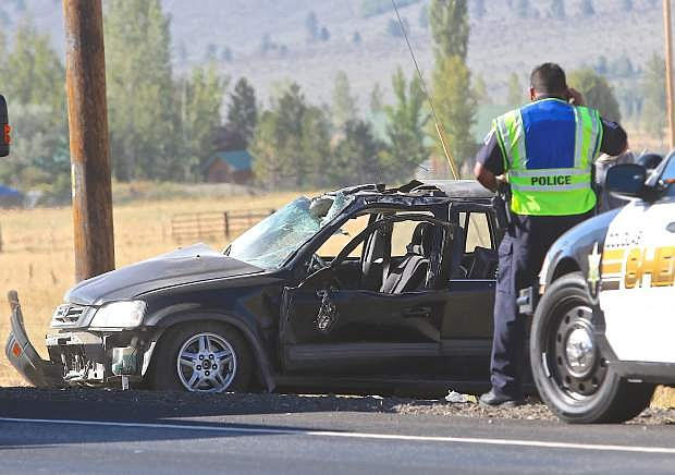 A totaled Honda CR-V is seen after a rollover accident on Hwy. 88 near Kimmerling road in Gardnerville Saturday morning.