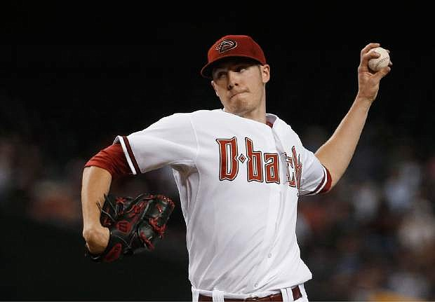 Arizona Diamondbacks' Patrick Corbin throws a pitch against the San Francisco Giants during the first inning in a baseball game on Friday, June 7, 2013, in Phoenix. (AP Photo/Ross D. Franklin)
