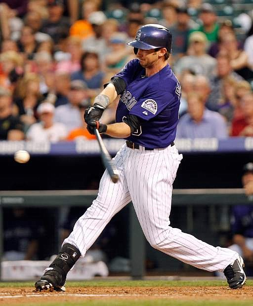 Colorado Rockies' Charlie Blackmon (19) hits a home run off of San Francisco Giants' Barry Zito during the third inning of a baseball game, Monday, Aug. 26, 2013, in Denver. (AP Photo/Barry Gutierrez)