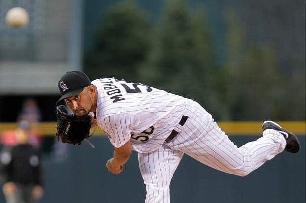 Colorado Rockies starting pitcher Franklin Morales throws during the first inning of a baseball game, Tuesday, April 22, 2014, in Denver. (AP Photo/Barry Gutierrez)