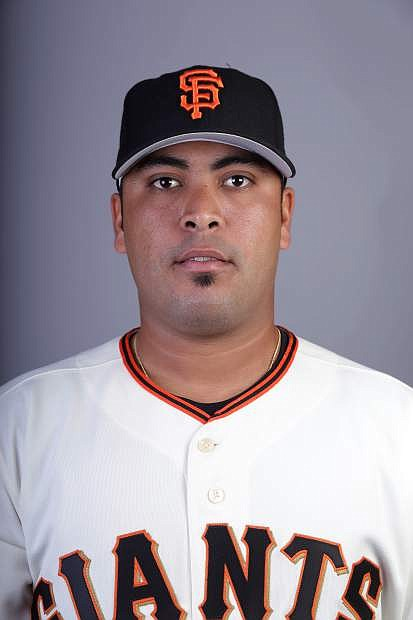 This is a 2014 photo of Hector Sanchez of the San Francisco Giants baseball team.  This image reflects the Giants active roster as of Sunday, Feb. 23, 2014, when this image was taken.  (AP Photo/ Gregory Bull)