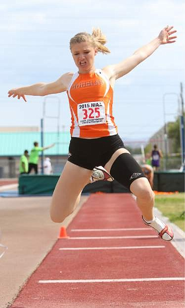Douglas High's Olivia Abbott finished second Friday in the NIAA State Championship triple jump.