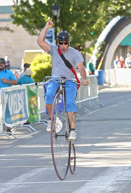 Jason Gardner of Carson City comes across the finish line on his Penny-Farthing during the Klunker Crit in downtown Carson City.
