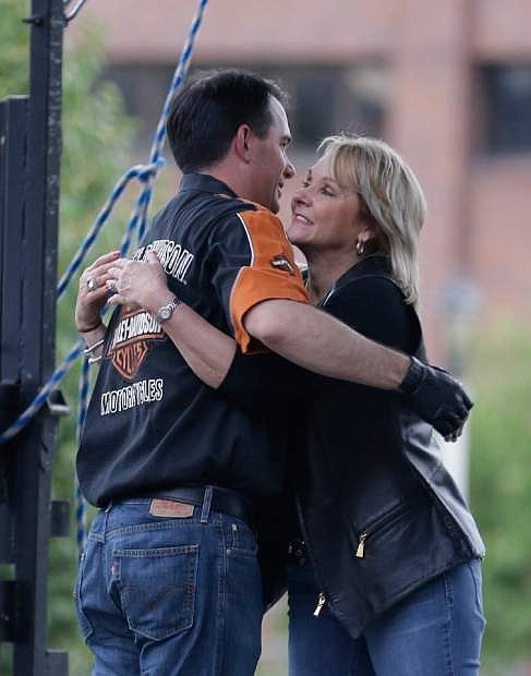 Oklahoma Governor Mary Fallin, right, and Wisconsin Governor Scott Walker embrace after they rode in to the Harley Davidson museum on Harley Davidson motorcycles Friday, August, 2, 2013 in Milwaukee. The National Governors Association is meeting in Milwaukee. (AP Photo/Jeffrey Phelps)