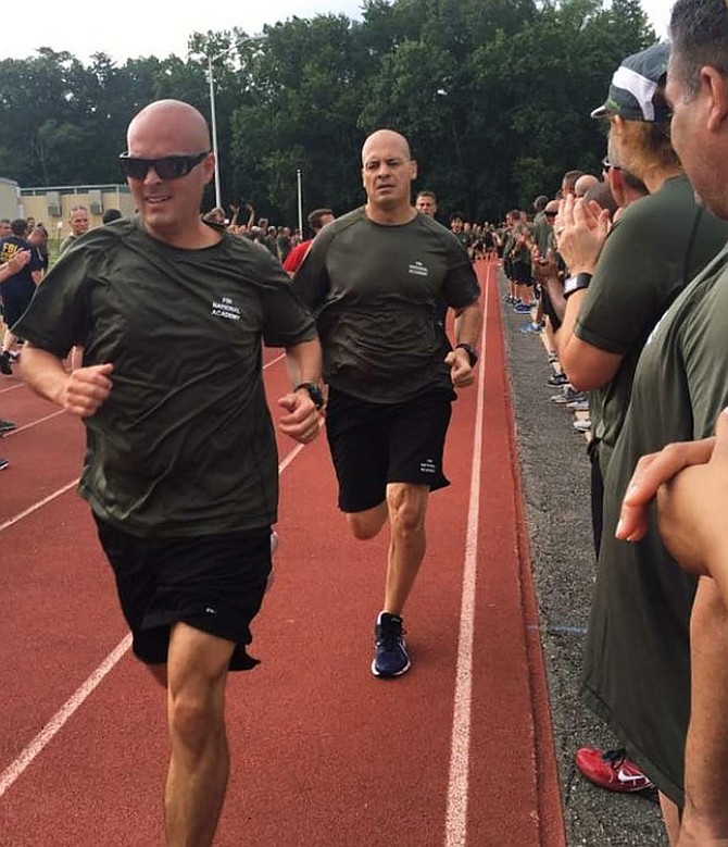 Carson City Lt. Brian Humphrey (front) trains with his fellow cadets at the FBI National Academy this summer. At the end of the training, the trainees had to run the imfamous Yellow Brick Road, a 6.1 mile course filled with two miles of obstacles.