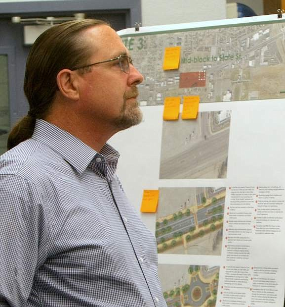 Carson City resident Maurice White views the various conceot designs for the future greening of William Street at at public workshop on Monday night.
