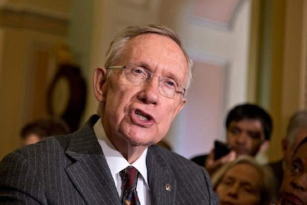 Senate Majority Leader Harry Reid, D-Nev., speaks with reporters following a Democratic strategy session at the Capitol in Washington, Tuesday, April 9, 2013. Reid said he plans showdown vote on gun control on Thursday. (AP Photo/J. Scott Applewhite)