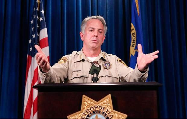 FILE - In this April 27, 2016, file photo, Las Vegas Metropolitan Police Sheriff Joe Lombardo briefs the media on a violent crime spike at a news conference at Las Vegas police headquarters. Sheriffs in most Nevada counties have come out against a background check initiative that gun control advocates are supporting on the ballot this November, but the top cop in the largest police agency in the state says he'll sit this one out. (Bizuayehu Tesfaye/Las Vegas Review-Journal via AP, File)