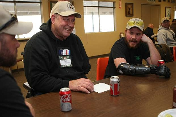 Matt Amos, Jim Sursely and Brian Meyer talk during lunch at the Capitol City Gun Club on Thursday during the sporting clays shoot that was part of the Wild Sheep Foundation Convention.