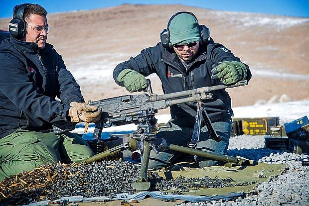 Dan Fassler and Chris Gonzales test fire U.S. Ordnance's new M240 medium machine gune at the company's firing range.