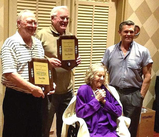Tom Ellis, left, and Sam Paulson, second from left, receive their Hall of Fame plaques from Julia Ruth Stevens, second from right, Babe Ruth's daughter, and Tom Stevens, Babe Ruth's grandson.